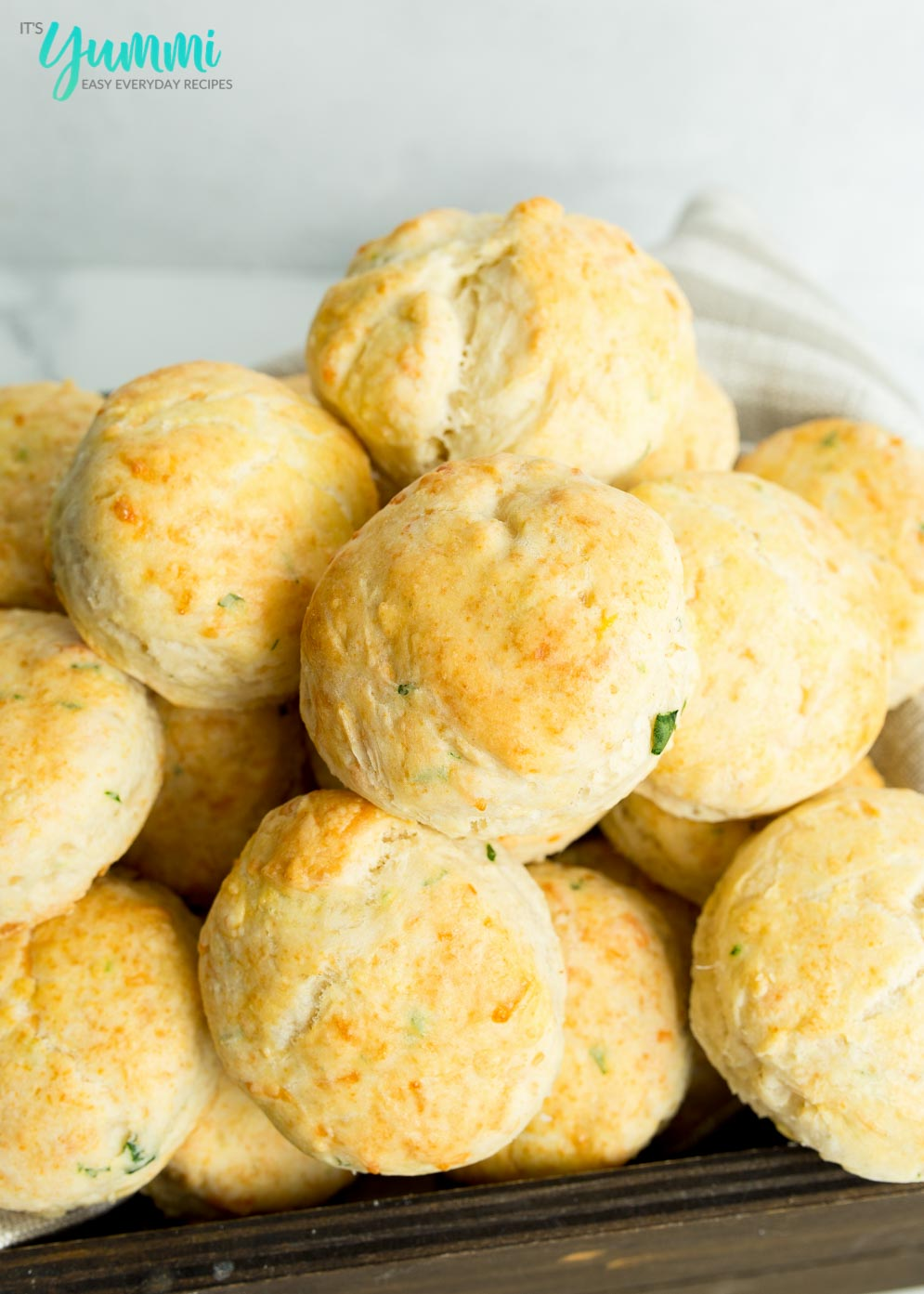 Close-up of Baked Cheddar Bay Biscuits in wooden basket