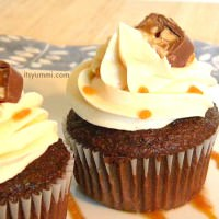 Snicker's Cupcake Recipe - These cupcakes are stuffed with caramel and Snicker's candy bars, then topped with caramel buttercream. Decadent dessert!
