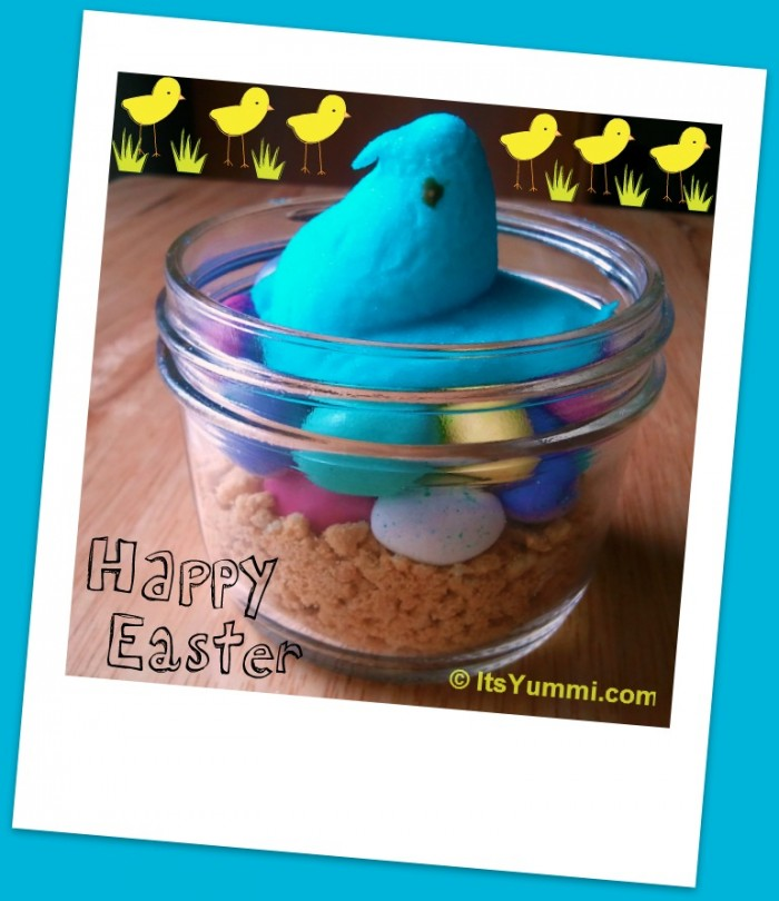 Blue Easter Marshmallow Peeps Centerpiece - marshmallow chick in a Canning Jar Sitting on crushed graham crackers and Malted Milk ball eggs
