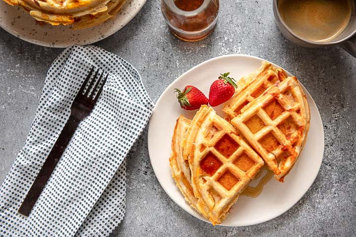 plate of savory waffles with syrup