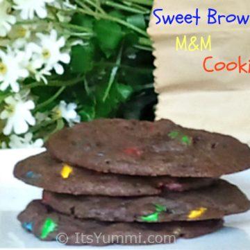 Chewy brownies meet crispy M&M cookies to create the ultimate chocolate sweet brownie cookie!