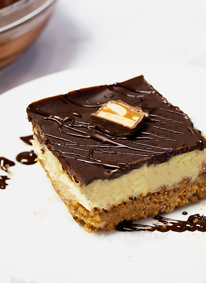 Snickers cheesecake bars with a brown butter crust