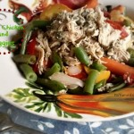 shredded low carb chicken and steamed vegetables in a bowl