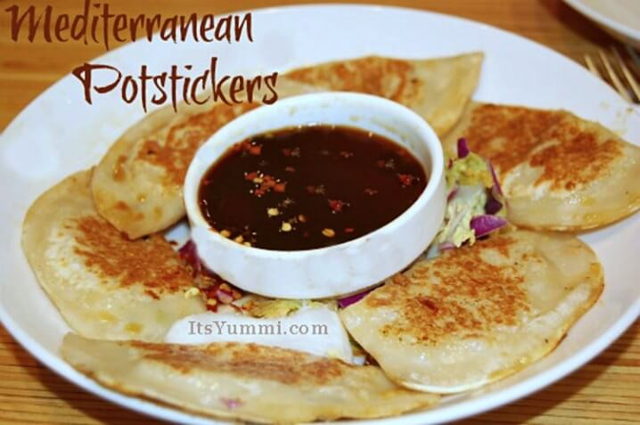Mediterranean Potstickers - Recipe from itsyummi.com - Easy appetizers like these are great for parties! These are a twist from the Asian version. They're filled with Napa cabbage, pork, and garlic. SO delicious!