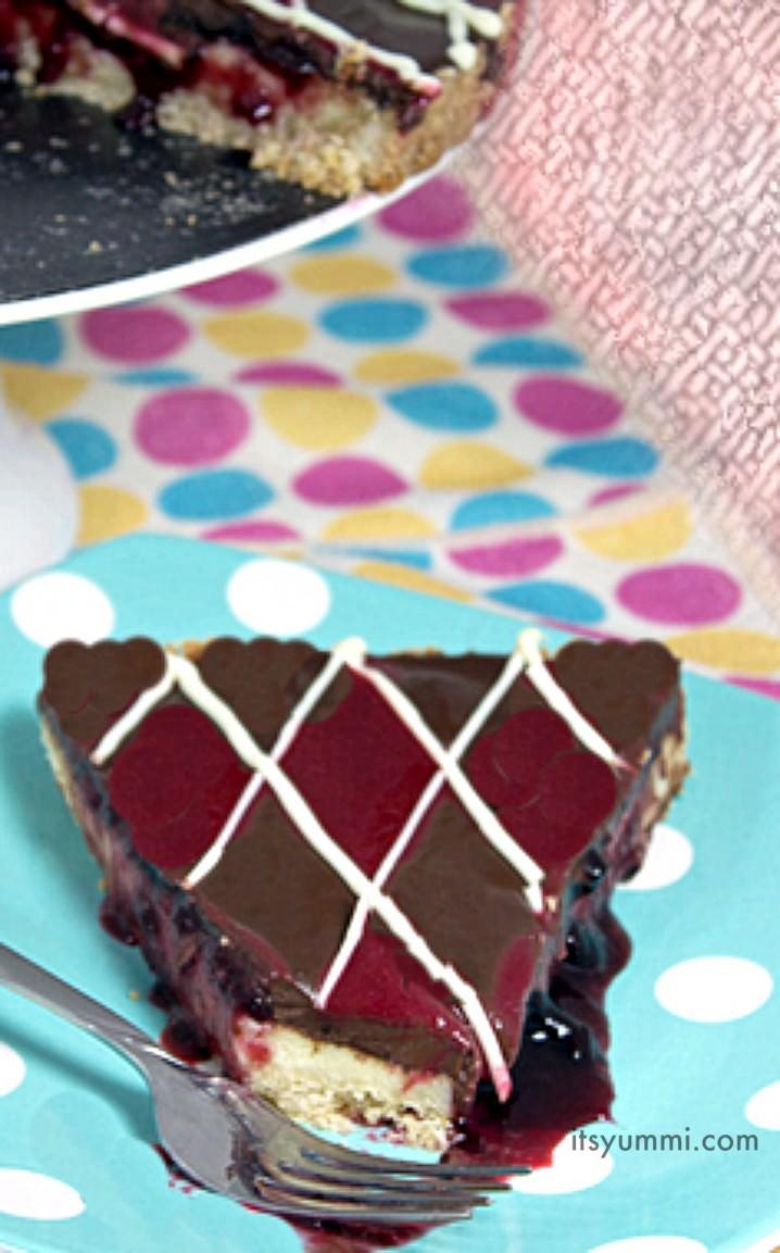 Double Chocolate Raspberry Cheesecake Tart - get the recipe on ItsYummi.com