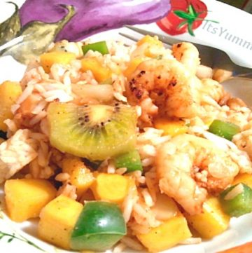Spicy grilled shrimp is paired with sweet tropical fruit and aromatic Jasmine rice to make a refreshing salad that can be eaten warm or cold. Get the recipe from ItsYummi.com