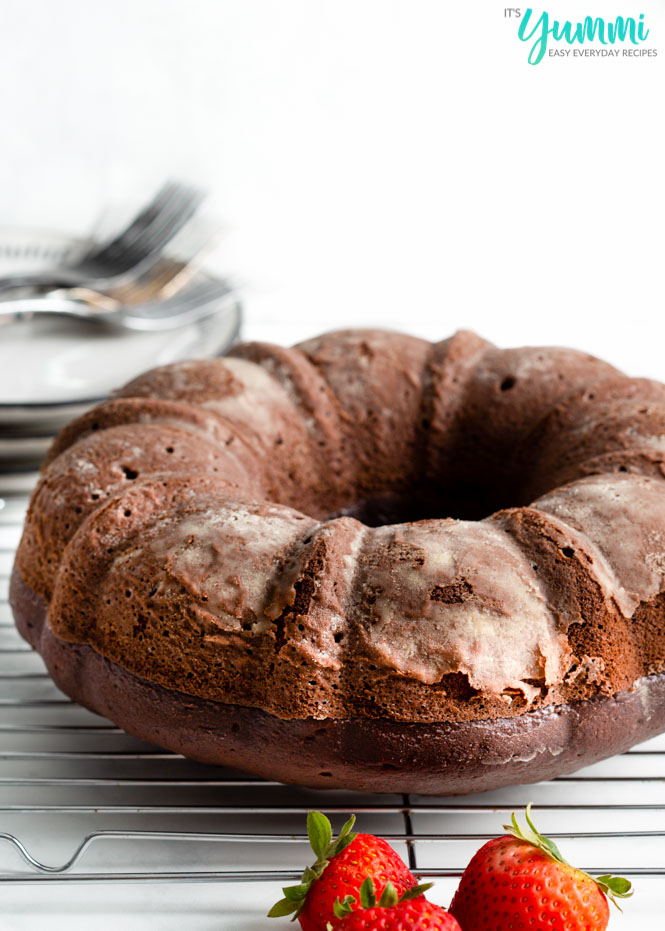 Easy Chocolate bundt cake is everything you dream of when you want a moist, decadent chocolate cake and a extra splash of coffee for good measure - Recipe on ItsYummi.com