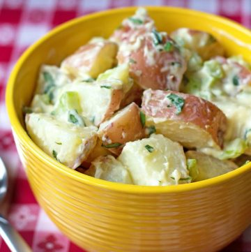 bowl of warm potato salad with fresh tarragon