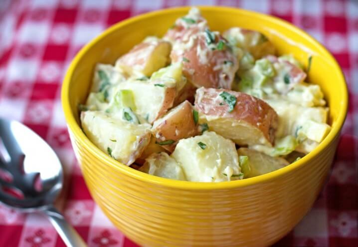 bowl of potato salad made with red potatoes and fresh tarragon