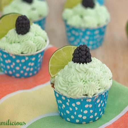 Vanilla bean cupcakes have been stuffed with fresh blackberries and topped with lime whipped cream frosting. Yummilicious treats from Chef Becca / ItsYummi.com