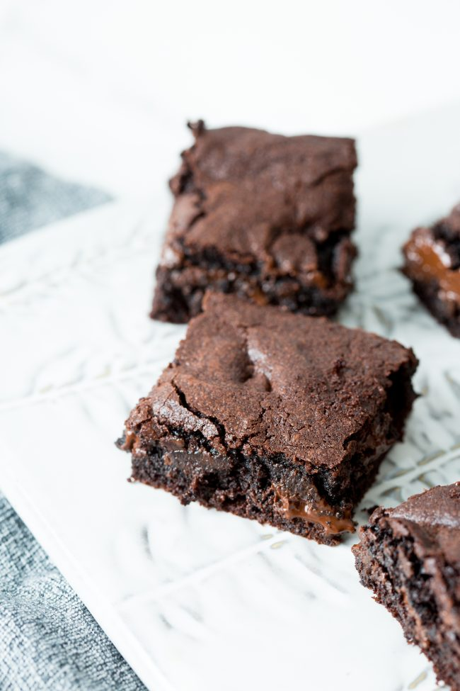 best ever brownies with chocolate chunks on a white platter