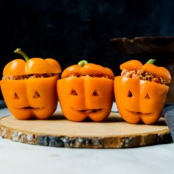 Halloween stuffed peppers carved to look like Jack O Lanterns