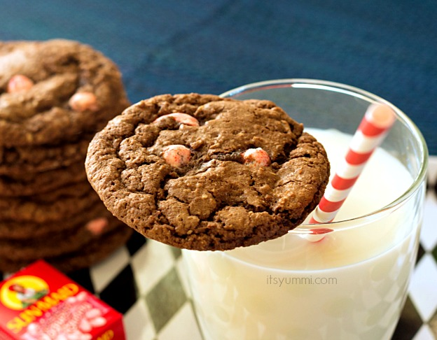 Chocolate Peppermint Cookie sitting on the edge of a glass of milk