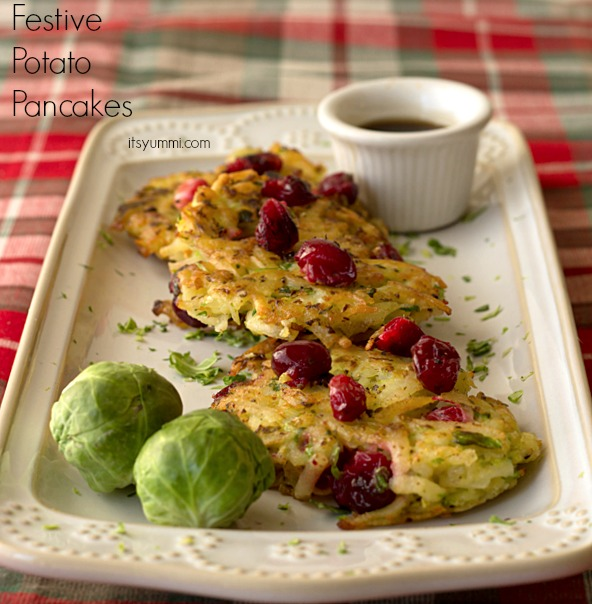 festive potato pancakes with cranberries and Brussels sprouts on a serving platter