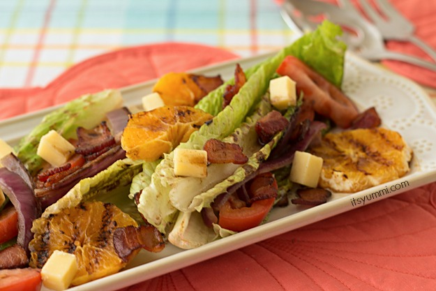 Grilled Romaine Salad with Pomegranate Balsamic Vinaigrette - Grilled romaine is paired with grilled oranges, bacon, blue cheese, and your favorite salad toppings for a delicious, healthy dinner! Get the recipe from @itsyummi