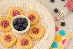I'm loving this cookie recipe! White Chocolate Shortbread Cookies with Blueberry Buttercream Icing from ItsYummi.com