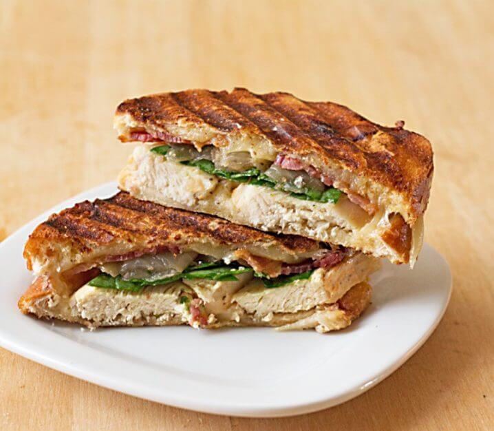 Cheesy Grilled Chicken Panini Sandwich - Crispy bacon, caramelized onions, baby spinach, and lots of cheese, grilled up between layers of 3-cheeses sourdough. Recipe from @itsyummi
