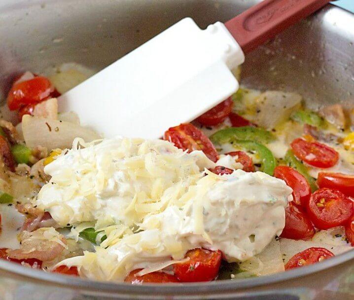 Roasted Veggie Skillet Dinner Recipe - mixing ingredients together