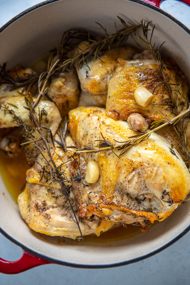 garlic herb oven roasted chicken in a Dutch oven pot