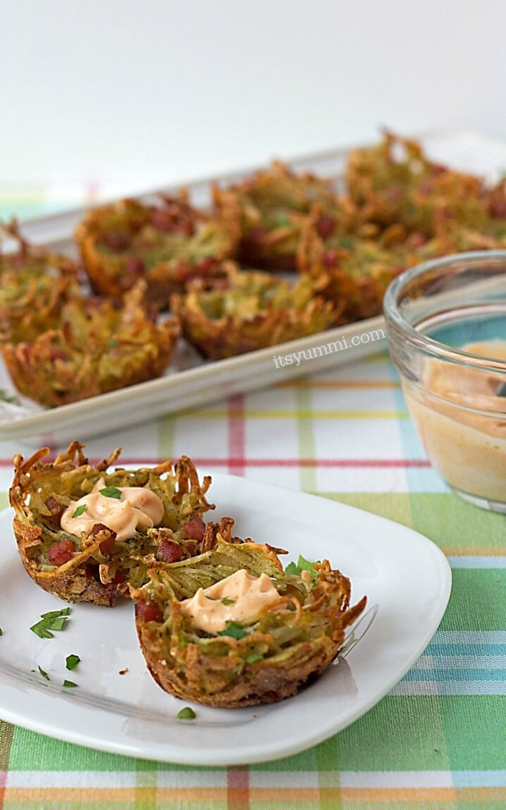 small plate and platter holding bite sized cheesy hash brown potato nests topped with ham, cheese and spicy aioli