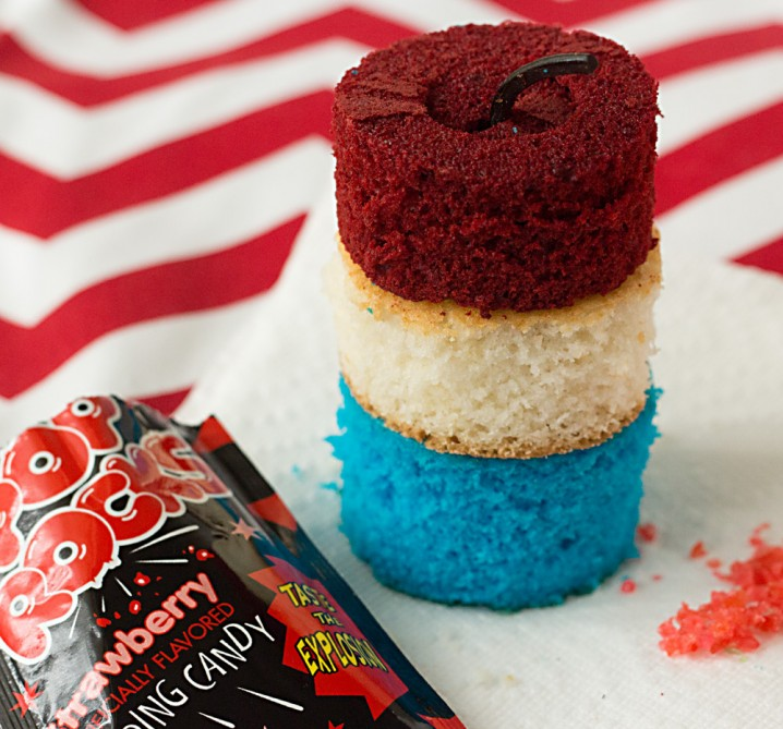 Firecracker Cupcakes Recipe from ItsYummi.com ~ These cupcakes are SO cute! They're loaded with Pop Rocks candy for an explosion of fun!