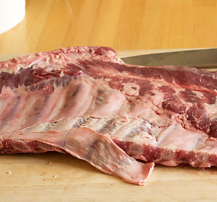 Removing silver skin from the underside of pork spare ribs