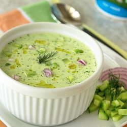 cold cucumber soup garnished with fresh dill and a drizzle of olive oil