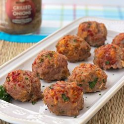 baked turkey meatballs without breadcrumbs on a white serving platter