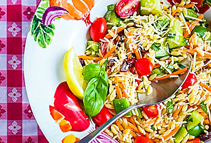pasta bowl filled with orzo salad made with summer vegetables