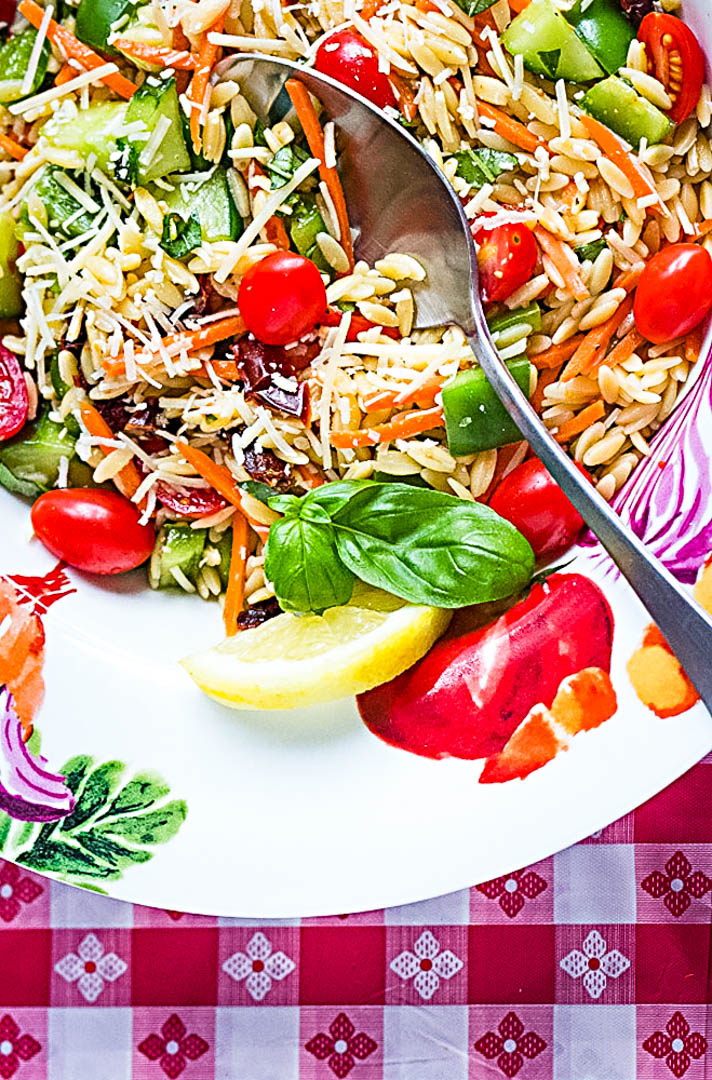 pasta salad with fresh vegetables in a pasta bowl