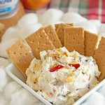 Cream cheese is mixed with apples, cranberries, walnuts, honey, and cinnamon for a low carb cream cheese dip recipe that makes a perfect holiday appetizer!