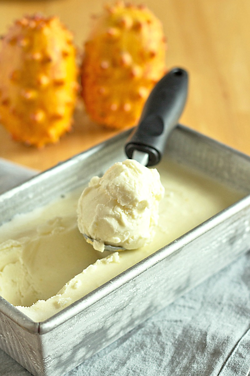 a metal loaf pan holds homemade vanilla orange ice cream made from horned melon fruit