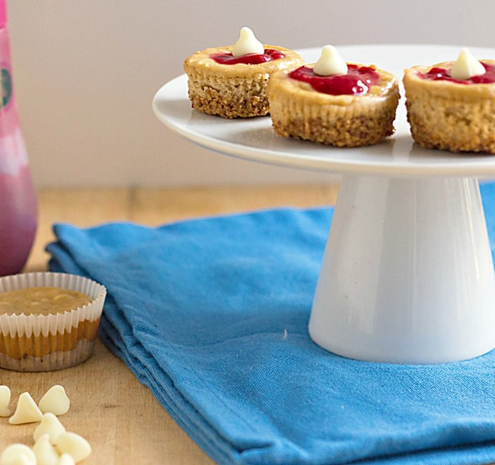 Raspberry Almond Low Carb Cheesecake Bites on a cake plate