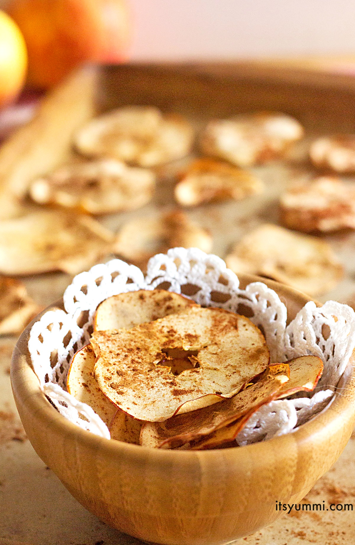 This baked cinnamon apple chips recipe is one of the tastiest and healthy snacks around. Thin slices of apples are dusted with cinnamon and crisply baked into a snack that you can feel good about.  Pack 'em in the lunch box and snack to your heart's content!