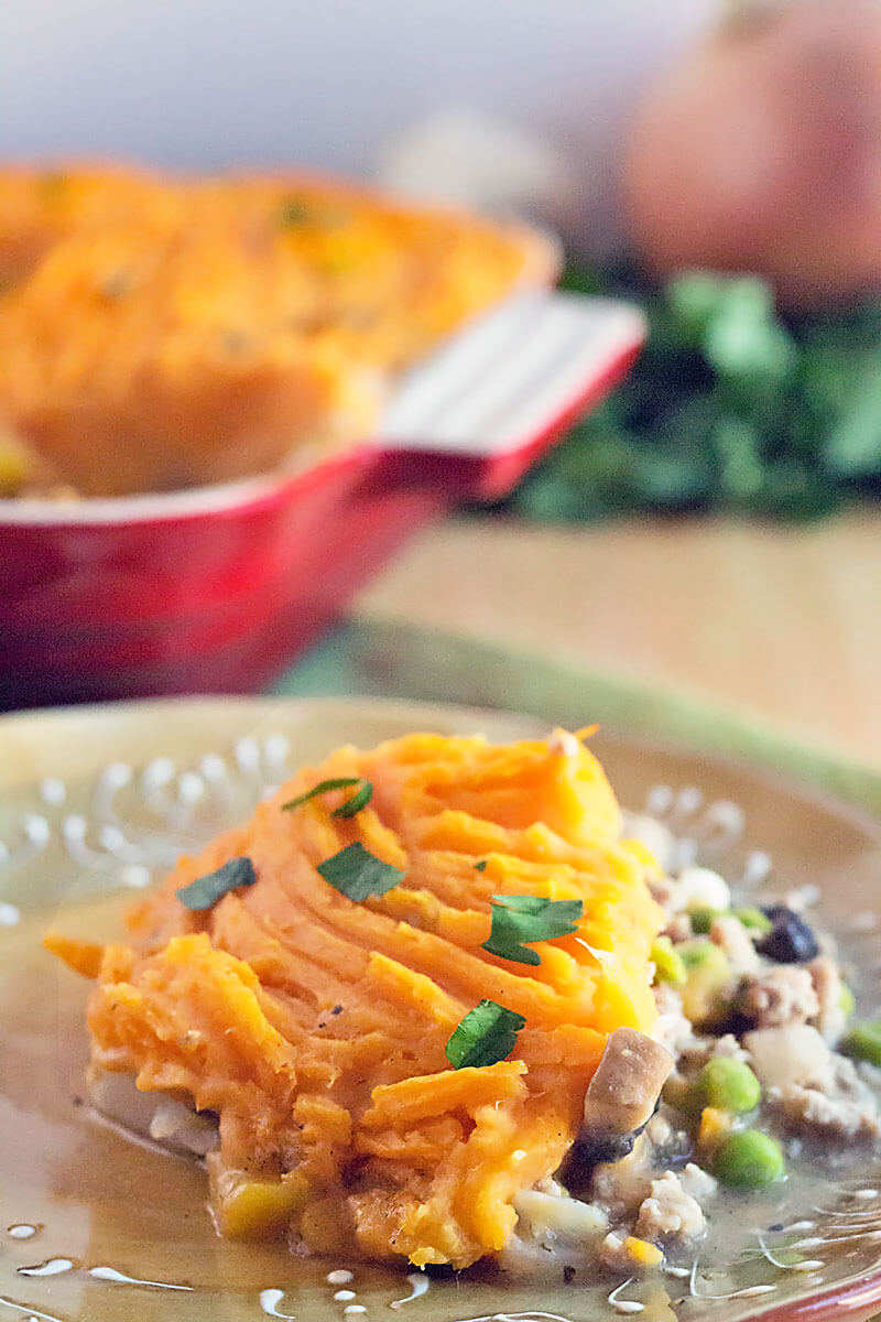 one serving of sweet potato shepherd's pie on a beige dinner plate