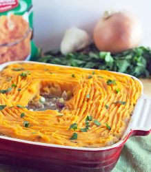 red square casserole dish with sweet potato shepherd's pie