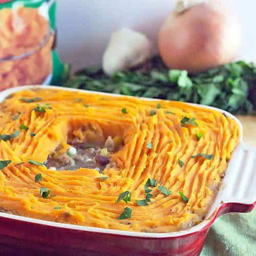 red square casserole dish with sweet potato shepherd's pie