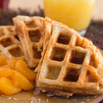 These whole wheat protein blender waffles are easily made in a blender for an easy weekday breakfast or weekend brunch. Freezable too! Get the easy waffles recipe on ItsYummi.com!