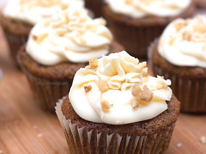 Give this carrot cake cupcake recipe a try and you'll get a bite full of yummi decadence! A carrot cake cupcake is topped with a maple walnut cream cheese frosting. SO yummi!