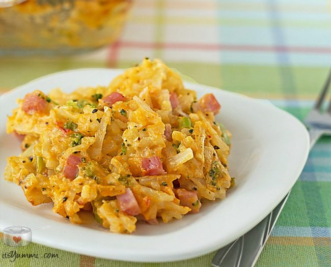 plate of hashbrown casserole with ham and cheese