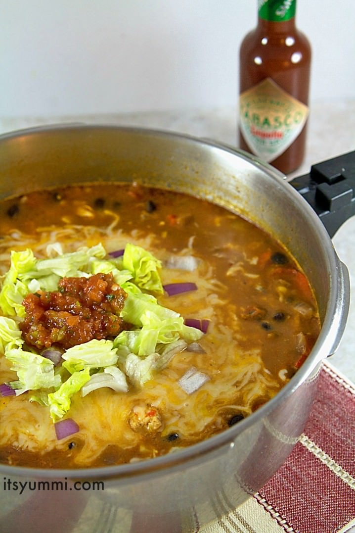 making a chicken enchilada soup recipe on the stove top