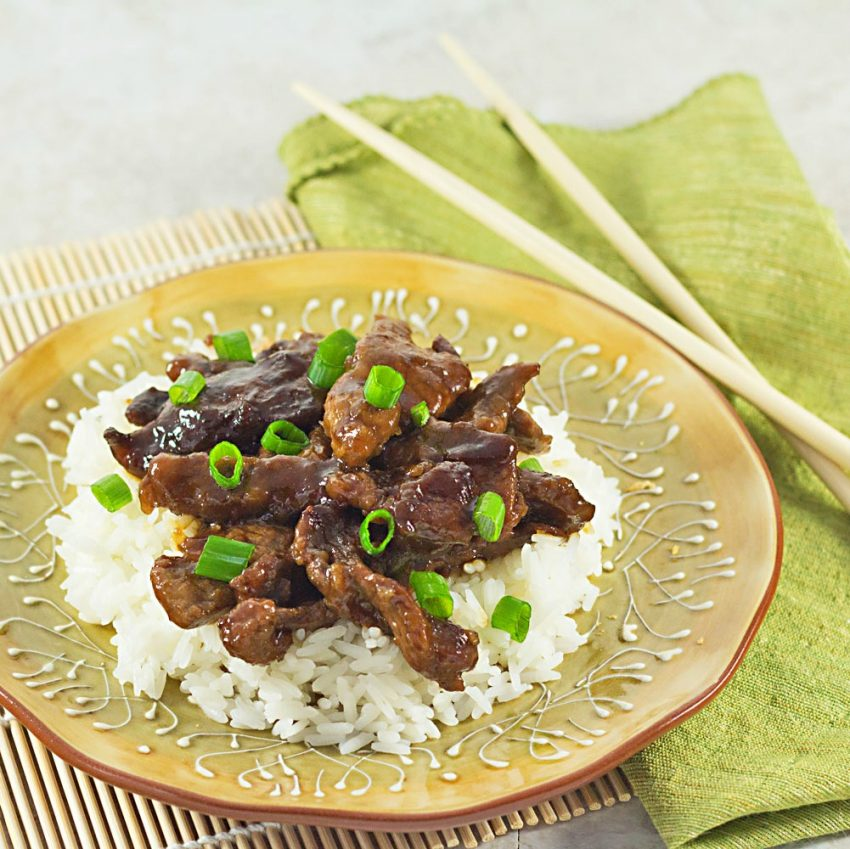 plate of Mongolian beef served over white rice