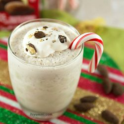 peppermint chocolate milkshake garnished with almonds and a candy cane
