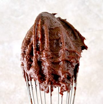 a whisk full of chocolate ganache without heavy cream