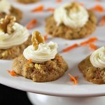 Carrot Cake Cookies with Cream Cheese Frosting - This cookie recipe will become one of your favorites! They taste just like a slice of carrot cake with cream cheese frosting. See the recipe on itsyummi.com