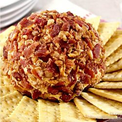 a bacon cheese ball with cream cheese, cheddar cheese, Colby cheese and chipotle peppers on a platter with crackers