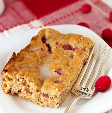 This recipe for cranberry banana bread bakes up as a delicious cross between bread and cake. Tart, fresh cranberries are paired with sweet bananas in a moist cake. It's made with some whole wheat flour to give it some stability.