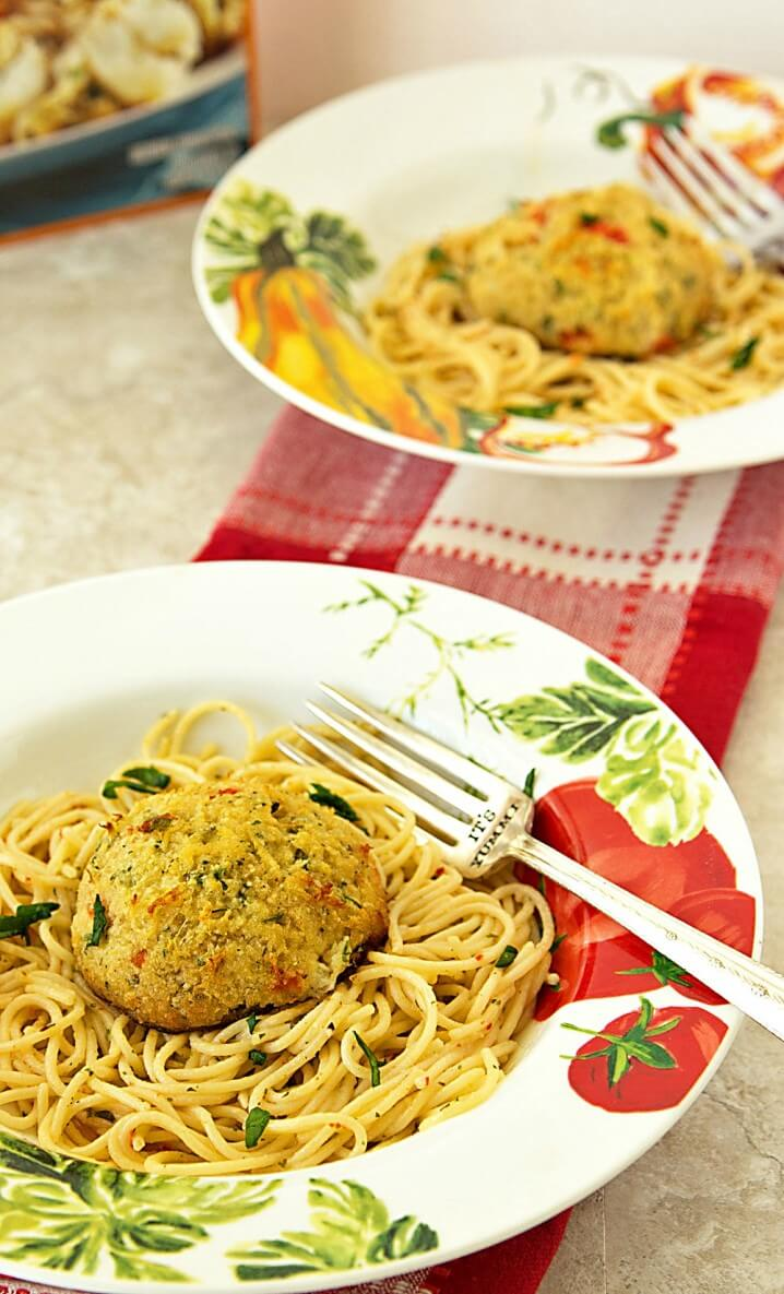 Fresh lump crab meat crab cakes served over a white wine and garlic butter sauce. This crab cake scampi recipe is perfect for a meatless dinner during Lent.