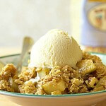 gluten free pear crumble with walnuts and a scoop of vanilla ice cream