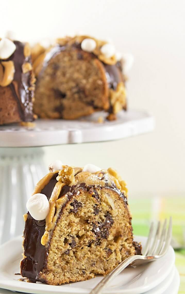 This Elvis on a Rocky Road bundt cake recipe will blow your mind! Peanut butter and bananas are combined with traditional rocky road flavors to create this delicious cake!